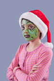 Girl with grinch like face paint. — Stock Photo