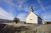 Old church and blue sky. — Stock Photo