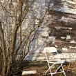 Old chair behind shed. — Stock Photo