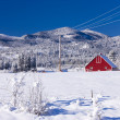 Red barn in snowy field. — Stock Photo