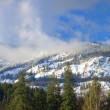 Pano of snow covered mountains. — Stock Photo