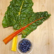 Chard and dish of blueberries. — Stock Photo