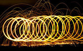 Spiraling long exposure fire. — Stock Photo