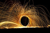 Twirling fire at night. — Stock Photo