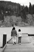 Mother and daughter on dock. — Stock Photo
