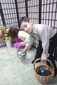 Boy takes Easter egg from sister. — Stock Photo