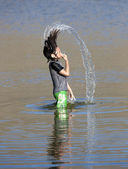 Girl hair flips with water. — Stock Photo