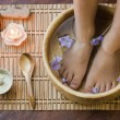 Soaking feet in wooden bowl. — Foto de Stock