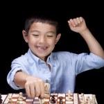 Boy celebrates chess win. — Stock Photo #30516741