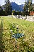 Iron chair in grass. — Stock Photo