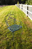 Empty chair on grass. — Stock Photo