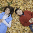 Siblings laying on ground. — Stock Photo