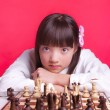 Girl relaxes during chess. — Stock Photo #38883627