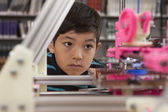 Boy watches printer in action. — Stock Photo