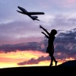 Boy flies a toy plane. — Stock Photo #49607685