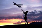 Boy flies a toy plane. — Stock Photo