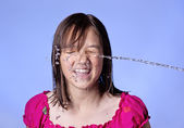 Girl squirted with water. — Stock Photo