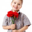 Smiling boy with bouquet of carnations — Stock Photo #10144432