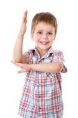 Kleiner junge mit seiner hand auferweckt — Stockfoto