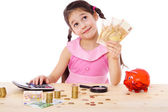 Girl at the table counts money — Stock Photo