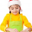 Little girl kneading for Christmas cooking — Stock Photo #12686583
