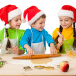 Three kids with Christmas cooking — Stock Photo