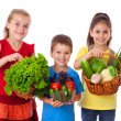 Smiling kids with fresh vegetables — Stock Photo