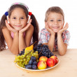 Stock Photo: Kids with plate of fruit