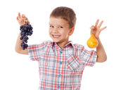 Smiling kid with grape and pear — Stock Photo