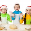 Royalty-Free Stock Photo: Three kids with Christmas cooking