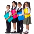 Smiling kids standing with folders — Stockfoto