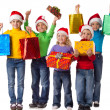 Group of happy kids with christmas gifts — 图库照片