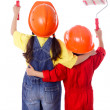 Two kids in coveralls with paint rollers — Stock Photo