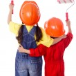 Two kids in coveralls with paint rollers — Stock Photo #14169528