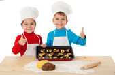 Two kids with baking and ok sign — Stock Photo