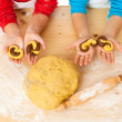 Royalty-Free Stock Photo: Child's hands with dough above the table