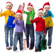 Group of happy kids with christmas gifts — Stock fotografie