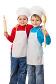 Little cooks with ladle and rolling pin — Stock Photo