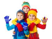 Group of three kids in winter clothes — Stock Photo