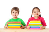 Kids with pile of books — Stock Photo
