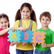 Three kids with letters — Foto de Stock