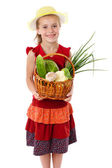 Smiling girl with basket of vegetables — Stock Photo