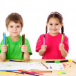 Two little kids with color pencils — Stock Photo #18818777