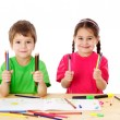 Two little kids with color pencils — Stock Photo