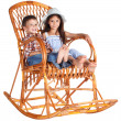 Royalty-Free Stock Photo: Two kids sitting in the rocking chair