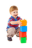 Little boy playing with cubes — Stock Photo
