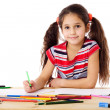 Smiling girl drawing in the notebook — Stock Photo