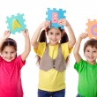 Three kids with letters — Stock Photo