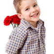 Stock Photo: Smiling boy hiding a bouquet