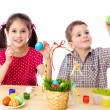 Two kids paint easter eggs — Stock Photo